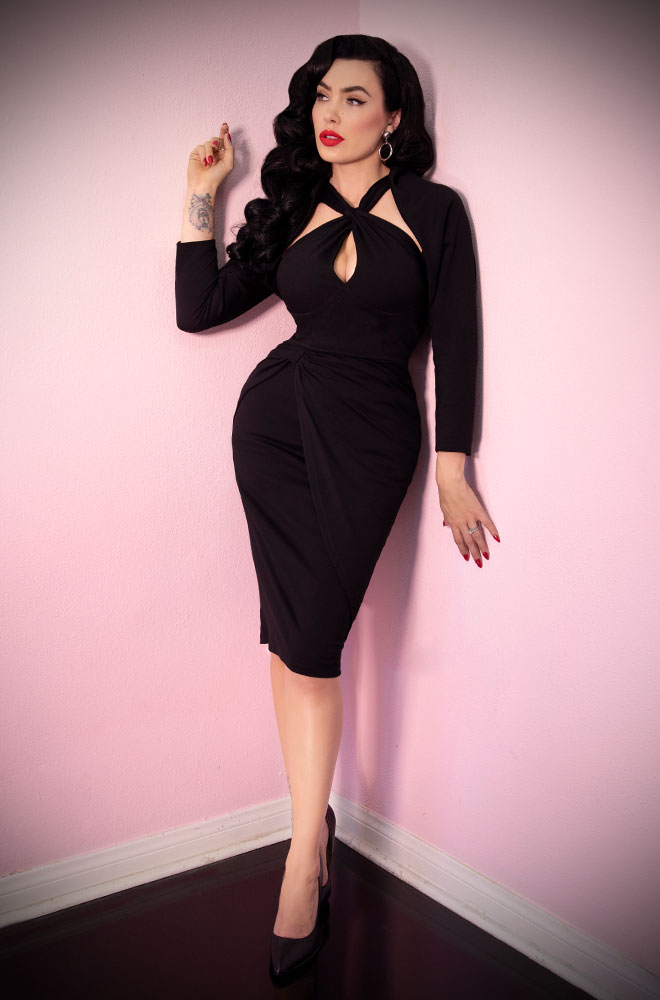 The Black Golden Era Dress features a matching bolero for gorgeous vintage style. Deadly is the Female are UK stockists of Vixen by Micheline Pitt.