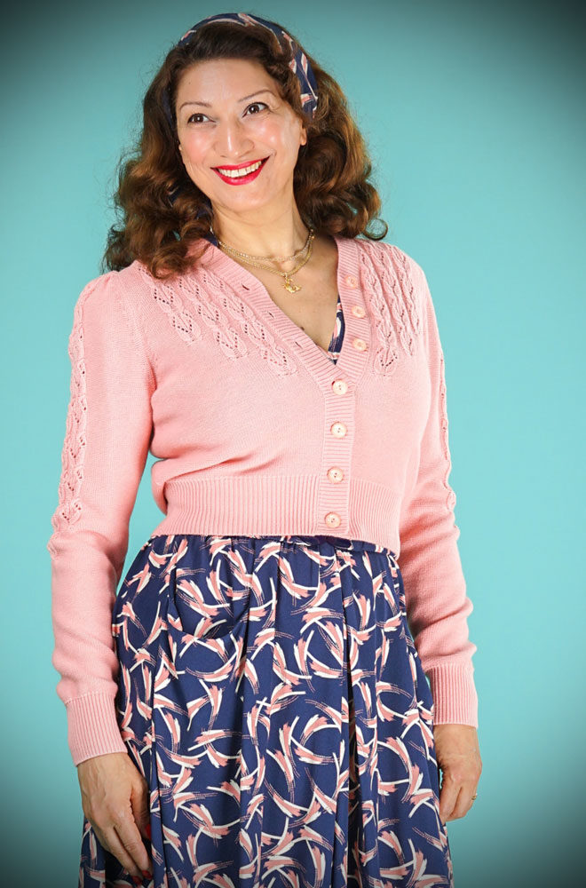 The Powder Pink Peggy Sue Cardigan is a wardrobe essential. The baby pink is soft & flattering to all skin tones. We are UK Stockists of Emmy Design.