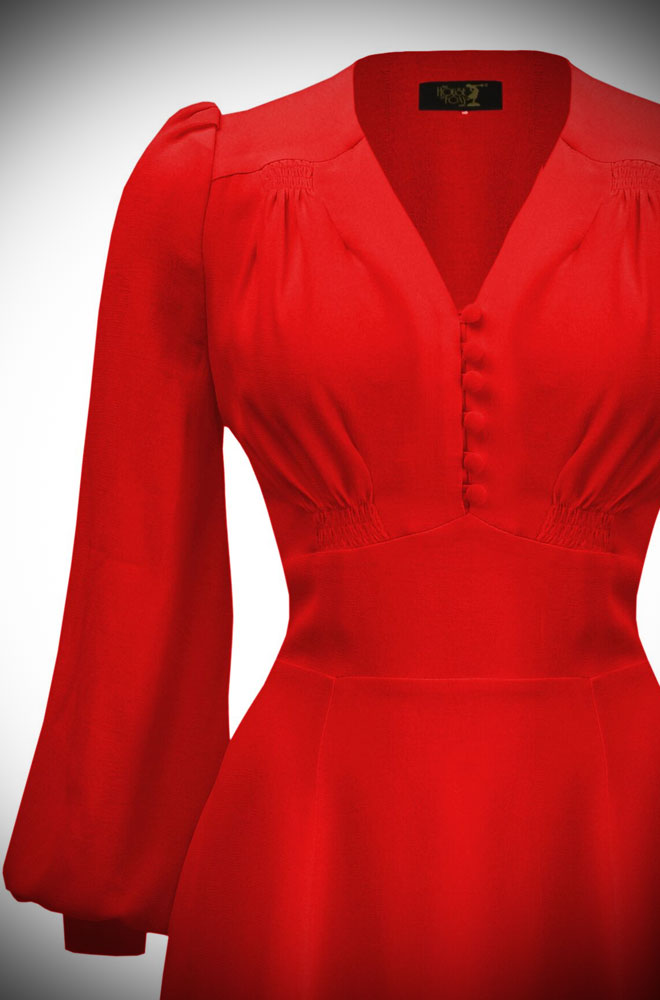 The Evelyn Dress is a stunning reproduction, late 1930s dress. This beautiful red dress is packed with vintage detailing.