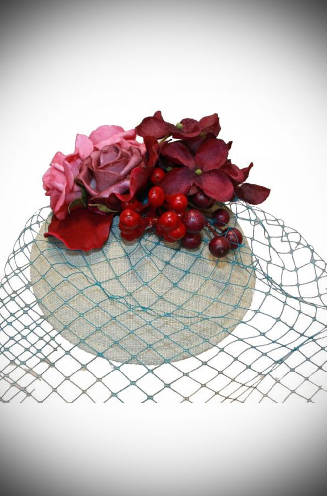 The Amelie Rose Fascinator is adorned with a delicate ensemble of roses & small berries on a soft mint green base. Effortless Vintage style in an instant!