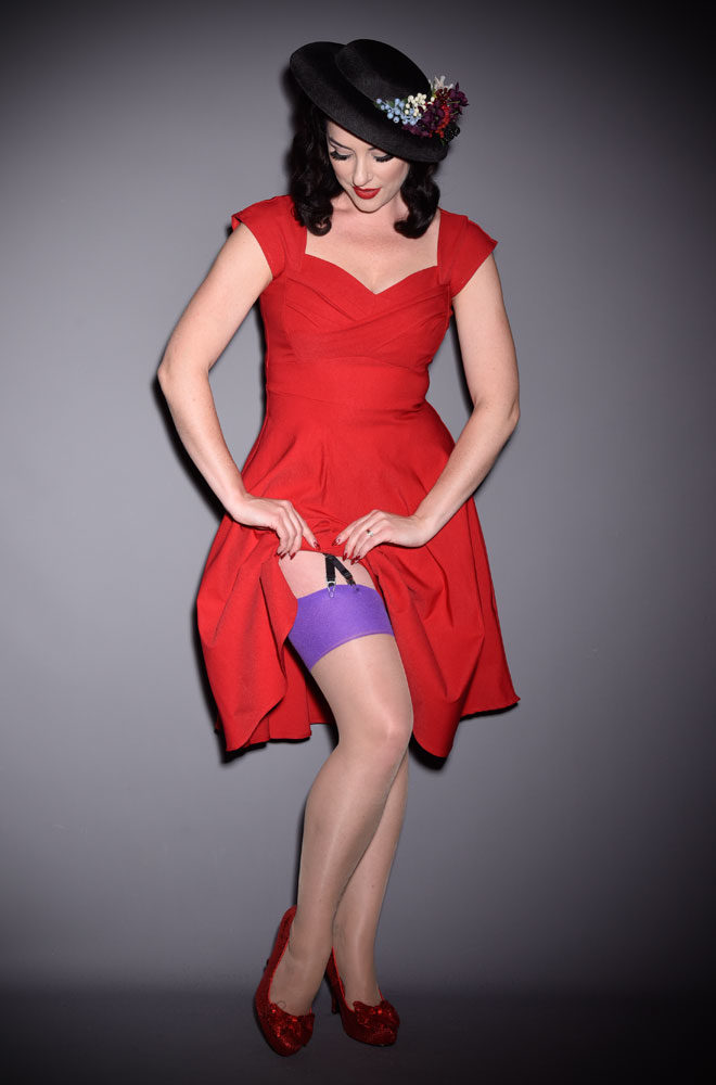 The Purple Glamour Seamed Stockings are sheer champagne nylons with a violet seam. They add a little bit of glamour to any outfit.