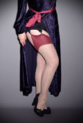 The Claret Glamour Seamed Stockings are elegant champagne nylons with a claret red seam. They add a little bit of glamour to any outfit.