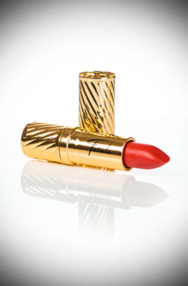 Introducing the Harlow Coral Fatale Cosmetics Lipstick. This striking lipstick is inspired by the screen goddess Jean Harlow. The warm coral-red with orange and pink undertones is perfect for those who prefer warm tones.