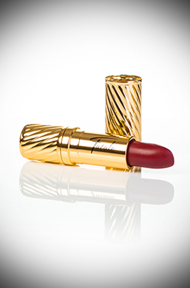 Rita Red Fatale Cosmetics Lipstick. This striking lipstick is inspired by the screen goddess Rita Hayworth. The sultry crimson-red with cool-blue and pink undertones is perfect for those who prefer cool tones.