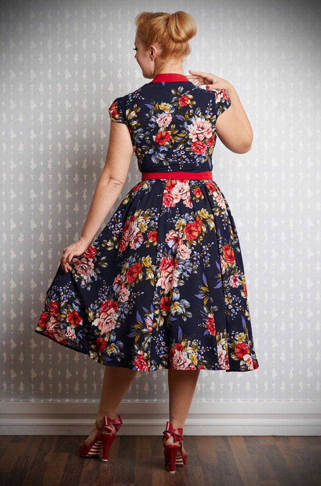 587fb407079a The Chelina Floral Swing Dress is a chic 50's style dress in a beautiful  navy and