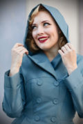 The Cleobella 50s Water Resistant Swing Coat is a stunning blue trench coat. This lightweight coat features a fantastic hidden hood!