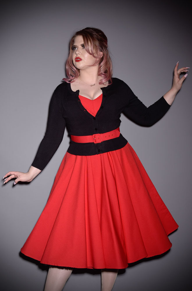 The Black Pretty Cardigan is a wardrobe essential. Throw it on day or night to stay warm and stylish! Perfect for pinups at DeadlyistheFemale.com