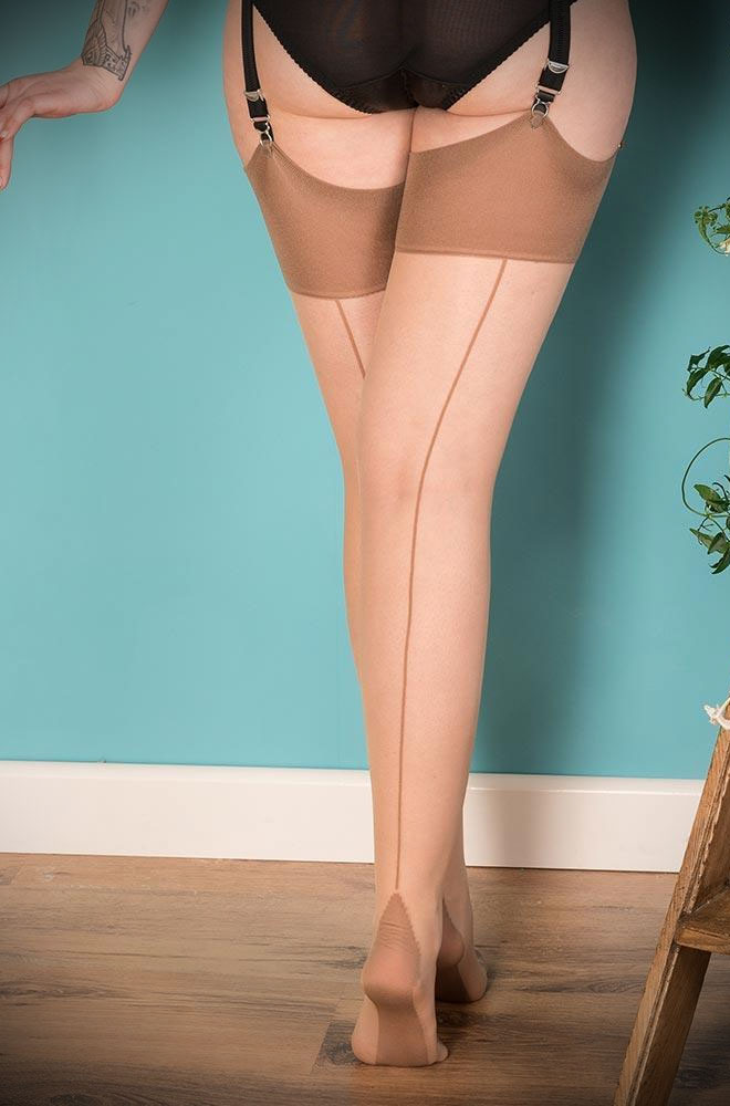 The Latte Glamour Seamed Stockings are sheer champagne nylons with a darket latte seam. They add a little bit of glamour to any outfit.