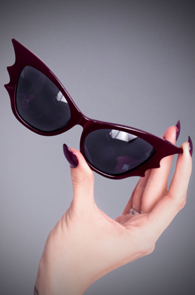 The Oxblood Vamp Batwing Cat-eye Sunglasses by La Femme En Noir. These unique batwing Cat-eye frames are quite special, instead of the single point, they have three, creating a batwing effect. Deadly is the Female are thrilled to be UK and European stockists of the cult label La Femme En Noir by Micheline Pitt and Lyna Haaga.