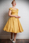 The Belle Glittery Swing Dress is a 50's style dress in sunshine yellow with a glittery tulle layer. Deadly is the Female are Miss Candyfloss UK stockists.