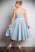 The Giselle Swing Dress is a darling 50's style dress in pale blue with a red rose bud print. Deadly is the Female are UK stockists of Miss Candyfloss.