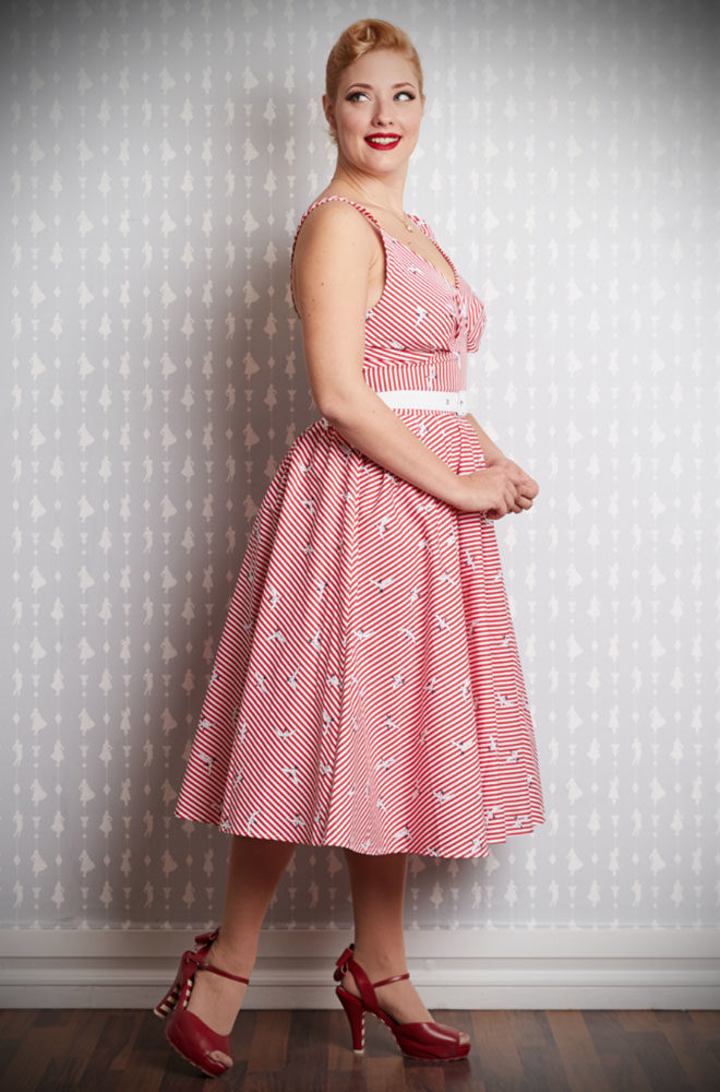 The Lilo Swing Dress is a sweet 50's style dress in red and white stripes with a seagull print. Deadly is the Female are UK stockists of Miss Candyfloss.