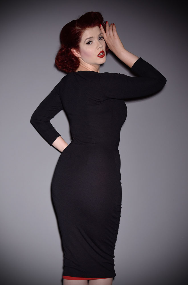 The Black Deadly Dress is an iconic stretch crepe wiggle dress. A signature piece for the Alexandra King for Deadly is the Female Collection.