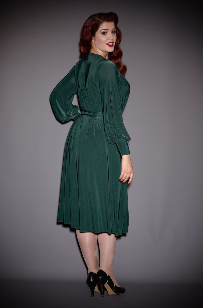 The Green Claudia Dress is a draped jersey dress with sash waist & bishop sleeves. A signature piece by Alexandra King for Deadly is the Female.