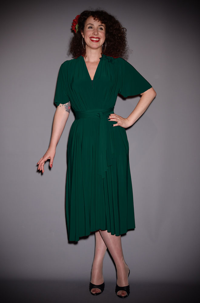 The Green Flutter Sleeve Claudia Dress is a draped dress with sash waist. A signature piece for the Alexandra King for Deadly is the Female Collection.