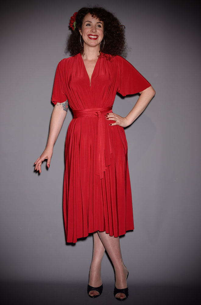 The Red Flutter Sleeve Claudia Dress is a draped jersey dress with sash waist. A signature piece for the Alexandra King for Deadly is the Female Collection.