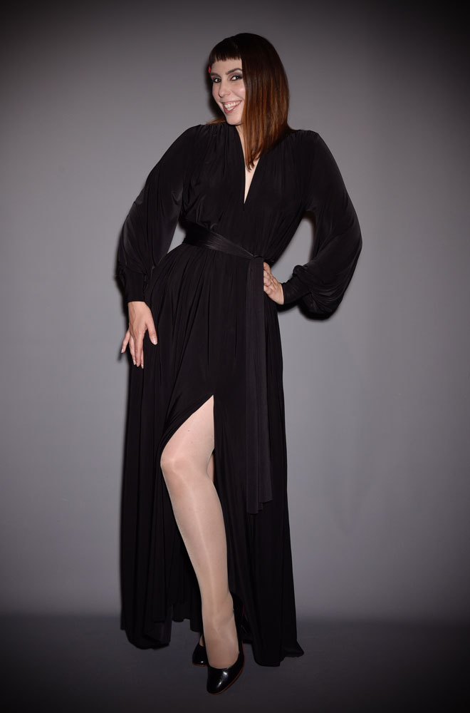 The Black Claudia Gown is a draped jersey evening dress with sash waist & bishop sleeves. A signature piece by Alexandra King for Deadly is the Female.