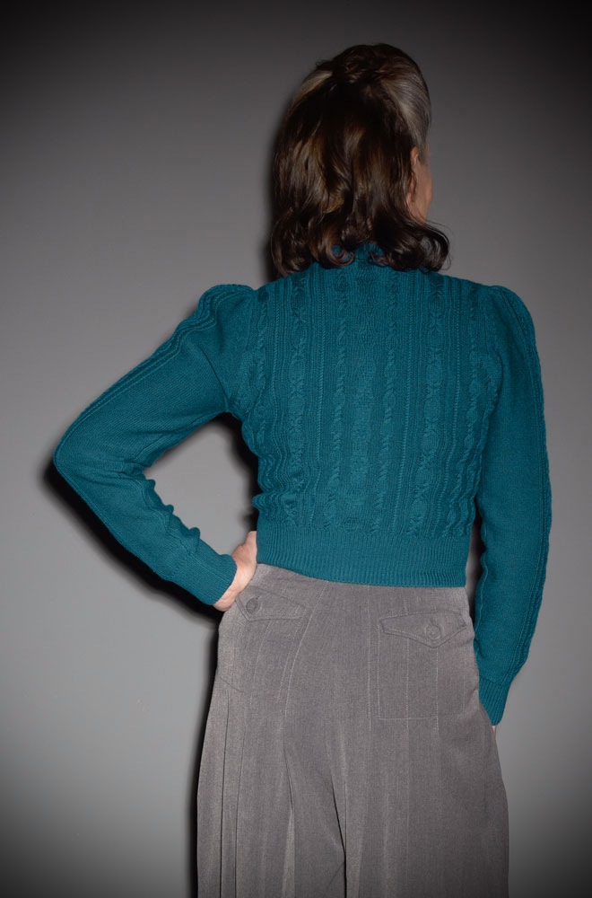 This 40's Teal Ice Skater Cardigan is a beautiful wardrobe essential. DeadlyistheFemale.com are official UK stockists of Emmy Design Sweden.