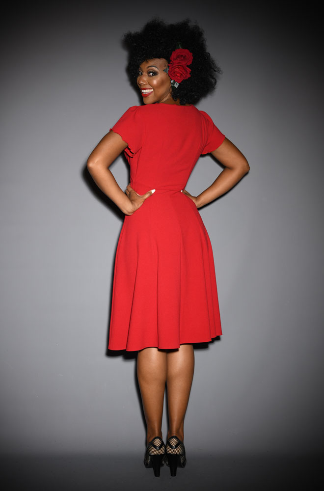 ed Betty Dress - designed to be as faithful as possible to the 40s styles. A slimming fit around the waist with elegant short sleeves. Perfect for dancing.