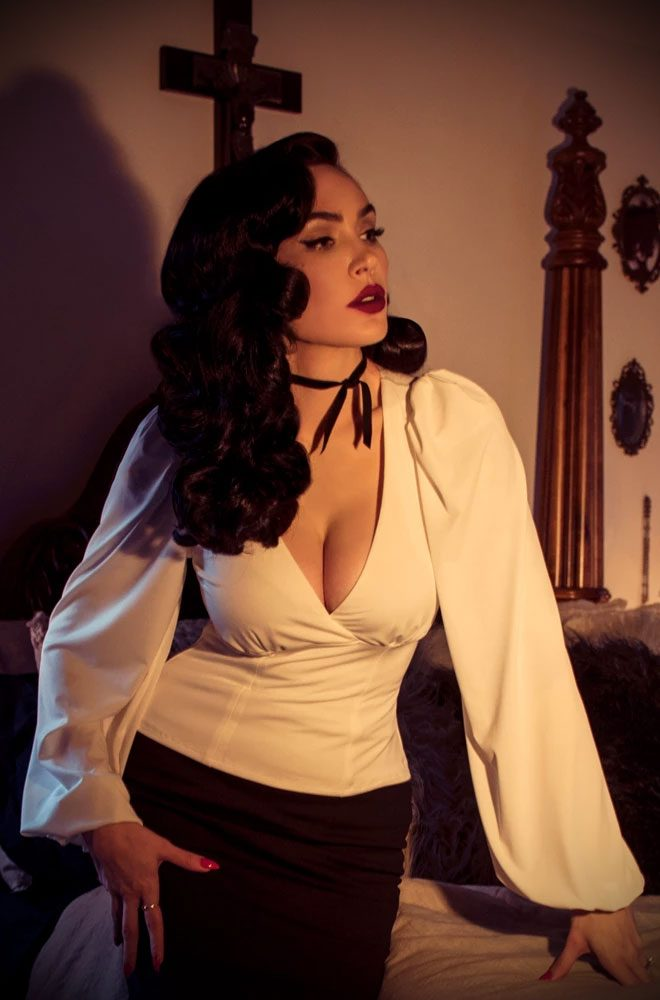 Ivory Bishop Sleeve Blouse, for vamps who can't live without a little drama! Deadly is the Female are official UK & European La Femme En Noir stockists