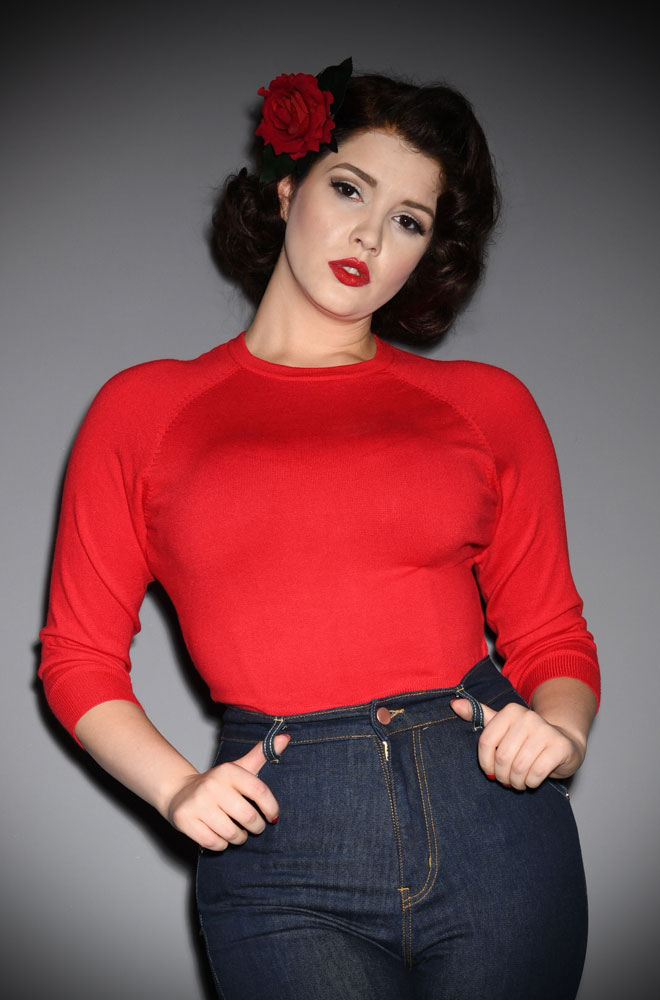 The Red Sweater Girl Top is a wardrobe essential. Based on the popular fashion of wearing tight sweaters (often over a bullet bra) in the late 1940s & 50s.