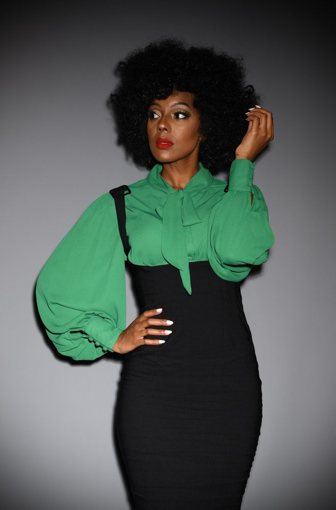 The Gwen Blouse is a vintage inspired emerald green pussy bow blouse by Unique Vintage at UK stockists, Deadly is the Female.