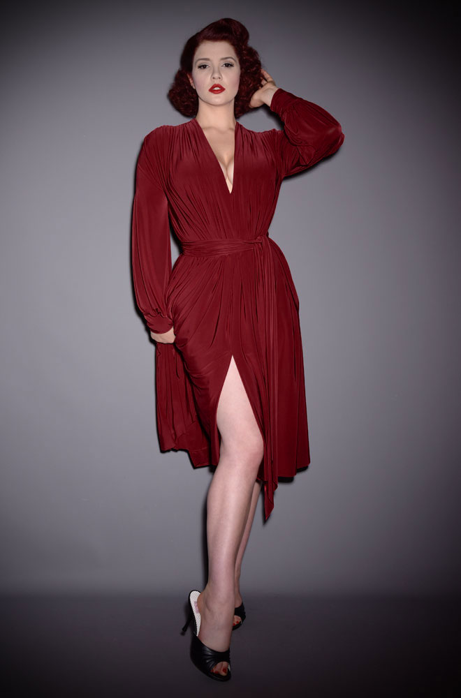 The Burgundy Claudia Dress is a draped jersey dress with sash waist & bishop sleeves. A signature piece by Alexandra King for Deadly is the Female.