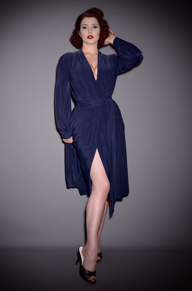 The Navy Claudia Dress is a draped jersey dress with sash waist & bishop sleeves. A signature piece by Alexandra King for Deadly is the Female.