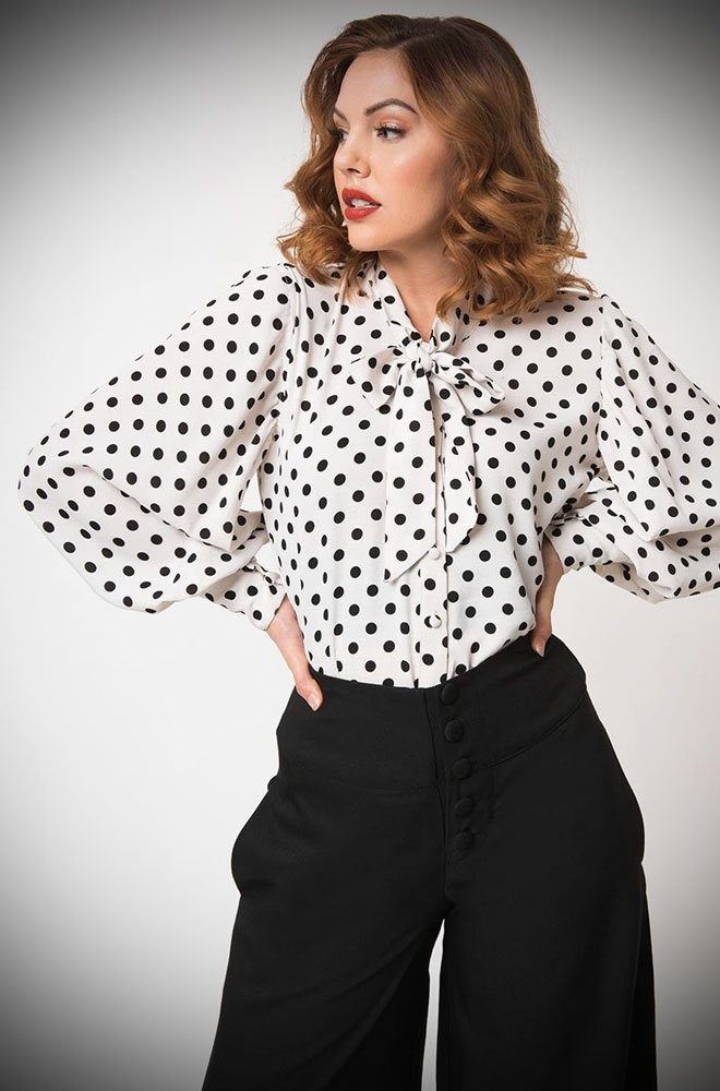 The White and Black Polka Gwen Blouse is a vintage inspired pussy bow blouse by Unique Vintage at UK stockists, Deadly is the Female.