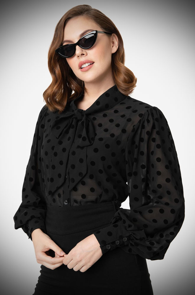 The Black Swiss Dot Gwen Blouse is a vintage inspired pussy bow blouse by Unique Vintage at UK stockists, Deadly is the Female.