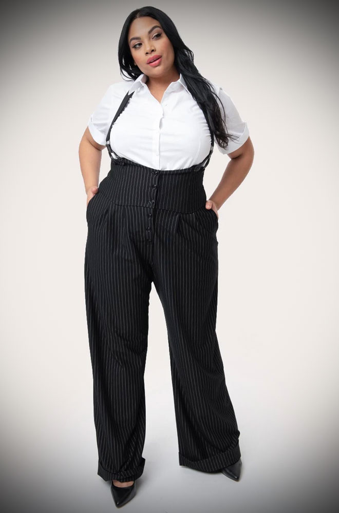 The Thelma Pinstripe Trousers are timeless high-waisted, wide-legged Trousers. We adore the Thirties feel of these. UK stockists of Unique Vintage.
