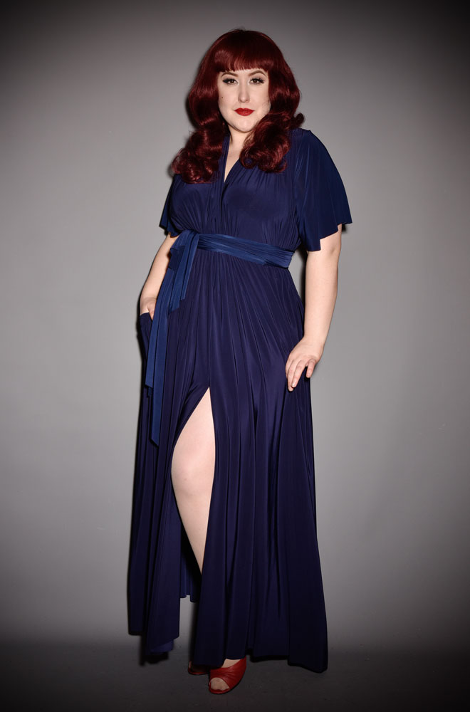 The Navy Flutter Claudia Maxi Dress is a draped jersey dress with sash waist. A signature piece for the Alexandra King for Deadly is the Female.