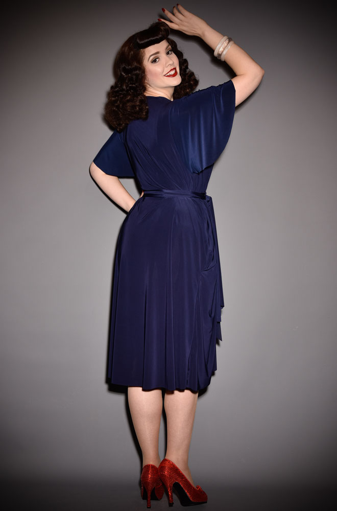 The Navy Flutter Sleeve Claudia Dress is a draped jersey dress with sash waist. A signature piece for the Alexandra King for Deadly is the Female.