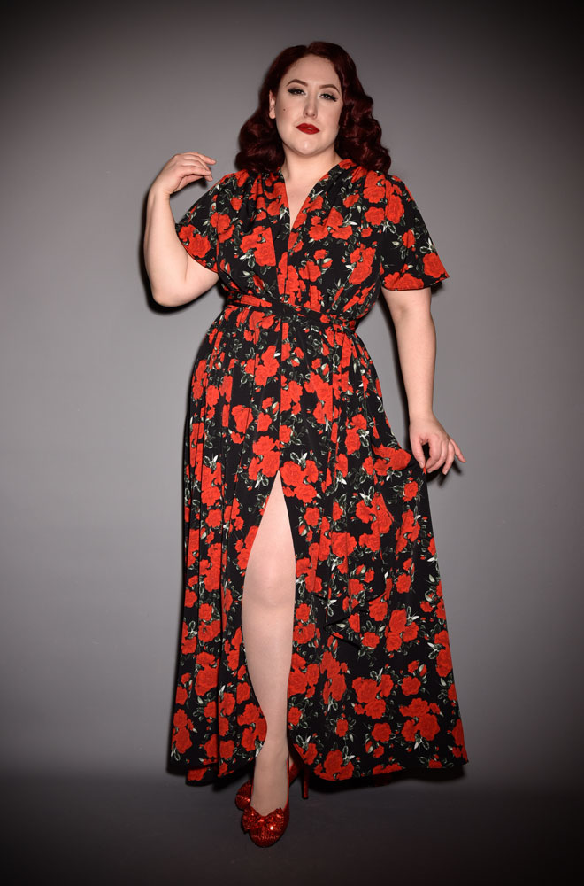 The Black Rose Flutter Sleeve Claudia Maxi Dress is a draped crepe dress with sash waist. A signature piece by Alexandra King for Deadly is the Female.