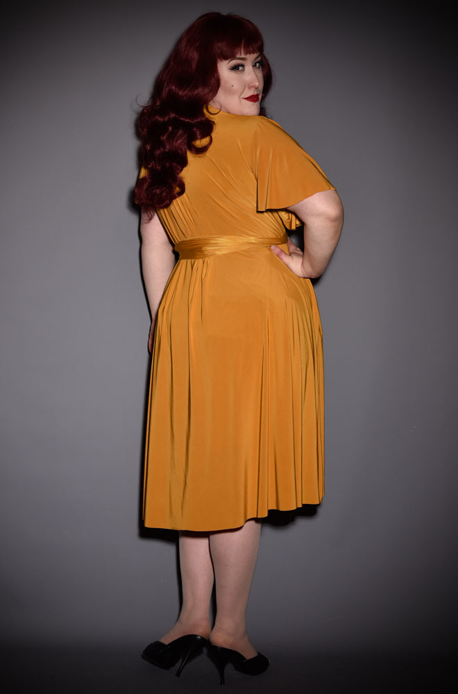 The Mustard Flutter Sleeve Claudia Dress is a draped jersey dress with sash waist. A signature piece for the Alexandra King for Deadly is the Female.