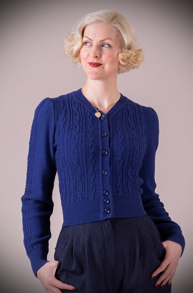 This Royal Blue 40's Ice Skater Cardigan by Emmy Design is a beautiful wardrobe essential available at UK stockists DeadlyistheFemale.com