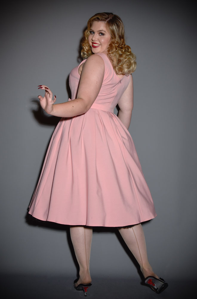 The Fiona Swing Dress is a chic 50's style dress in a beautiful blush pink. Deadly is the Female are UK stockists of Miss Candyfloss.