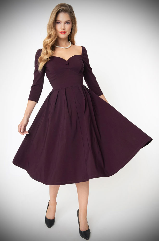 Lamar Swing Dress - aubergine swing dress with three-quarter sleeves & 1950s vintage appeal. Deady are official Unique Vintage UK stockists.