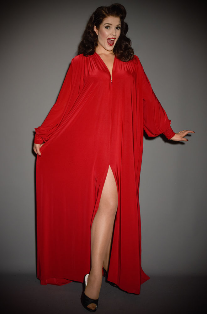 The Red Claudia Gown is a draped jersey evening dress with bishop sleeves. A signature piece by Alexandra King for Deadly is the Female.