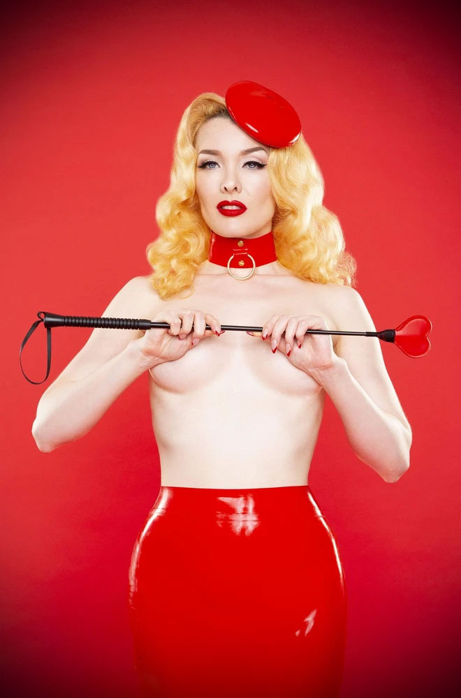 Fun heart-shaped faux leather riding crop from Bettie Page. Features a red heart hip, a rubber handle for grip & wrist loop.