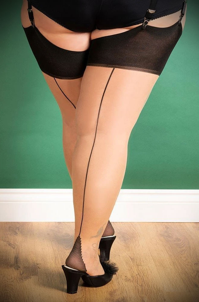 The Black Contrast Curve Seamed Stockings are sheer champagne nylons with a wine red seam. Designed for curvier thighs. Fits UK sizes 18-26