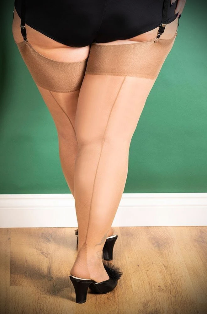 The Latte Curve Seamed Stockings are sheer champagne nylons with a darker latte seam. Designed for curvier thighs. Fits UK sizes 18-26