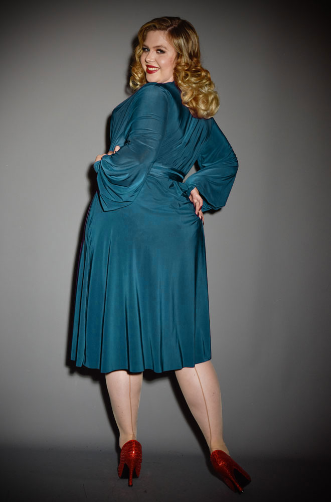 The Teal Claudia Dress is a draped jersey dress with sash waist & bishop sleeves. A signature piece by Alexandra King for Deadly.