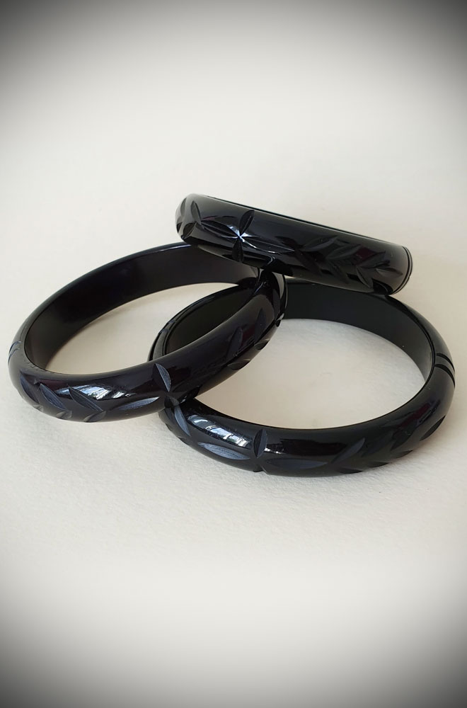 Based on vintage designs for an authentic look, the carved fakelite Elsie bangle in Black! Coordinating seamlessly with the Elsie hoops.
