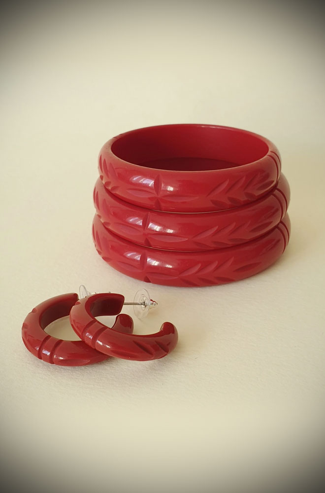 Based on vintage designs for an authentic look, the carved fakelite Elsie bangle in Cherry Red! Coordinating seamlessly with the Elsie hoops.