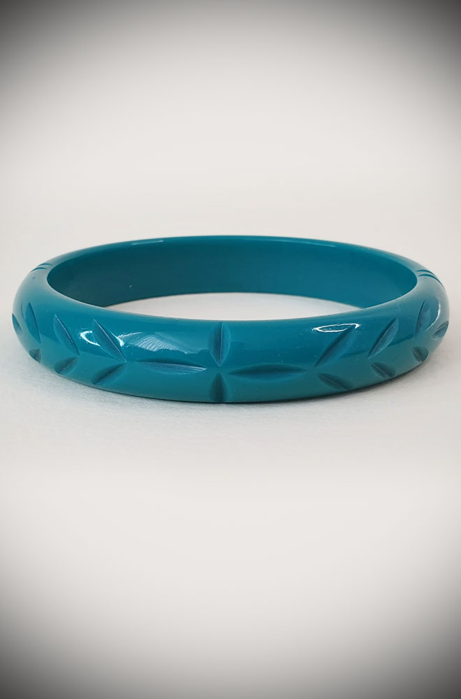 Based on vintage designs for an authentic look, the carved fakelite Elsie bangle in Teal! Coordinating seamlessly with the Elsie hoops.