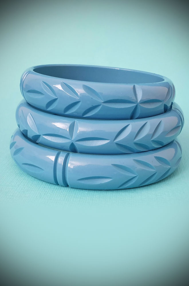 Based on vintage designs for an authentic look, the carved fakelite Elsie bangle in Dusty Blue! Coordinating seamlessly with the Elsie hoops.