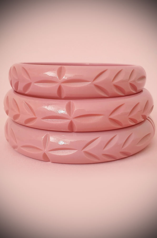 Based on vintage designs for an authentic look, the carved fakelite Elsie bangle in Dusty Pink! Coordinating seamlessly with the Elsie hoops.