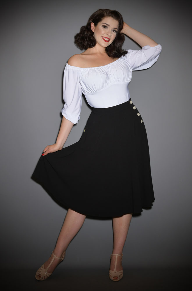 We are so excited about the graceful Black 40s Whirlaway Skirt! It is so versatile and will take you from work to the dance floor with ease!