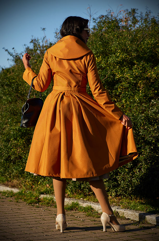 Lorin-Marigold Water Resistant Swing Coat - a stunning 1950's gold coat with a hood. Deadly is the Female are Miss Candyfloss UK stockists.